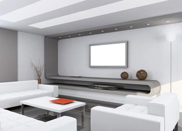 Omnipresente Una de las opciones más realista. Una parte del salón diseñada para rendirse a la presencia de una gran pantalla.